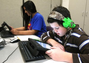 Students listen to audiobooks at Arcola Elementary