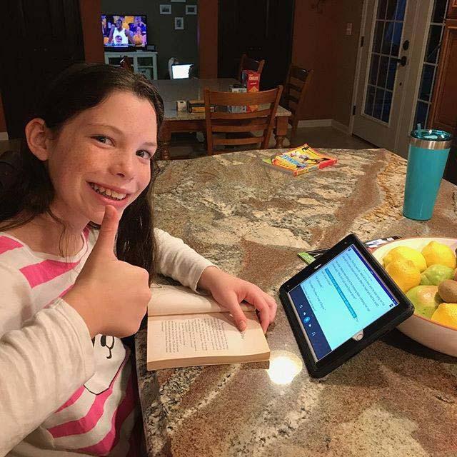 Tween studying with audiobook