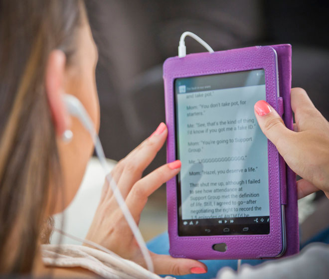 student reading an audiobook