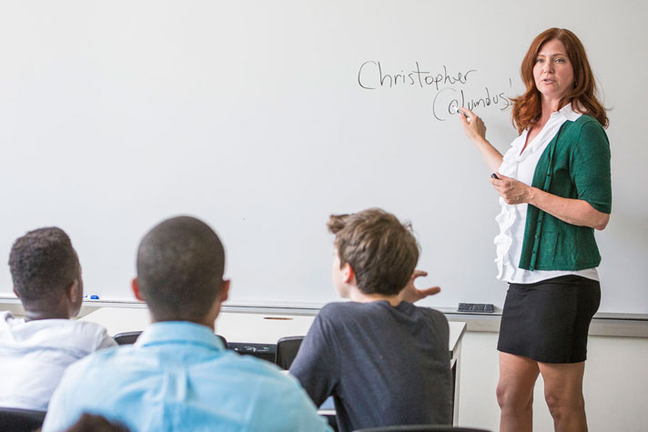 an educator working with students