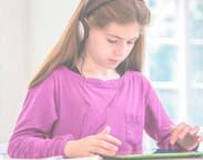 Young female student using an audiobook
