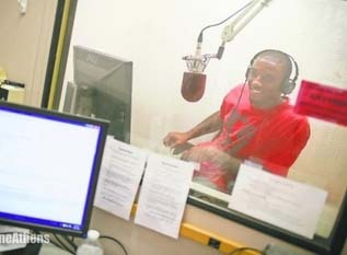 Malcolm Mitchell in a recording booth