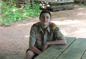Eagle Scout sitting at picnic table