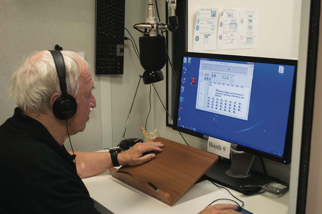 volunteer recording a learning ally book