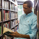 photo of a student reading in the library
